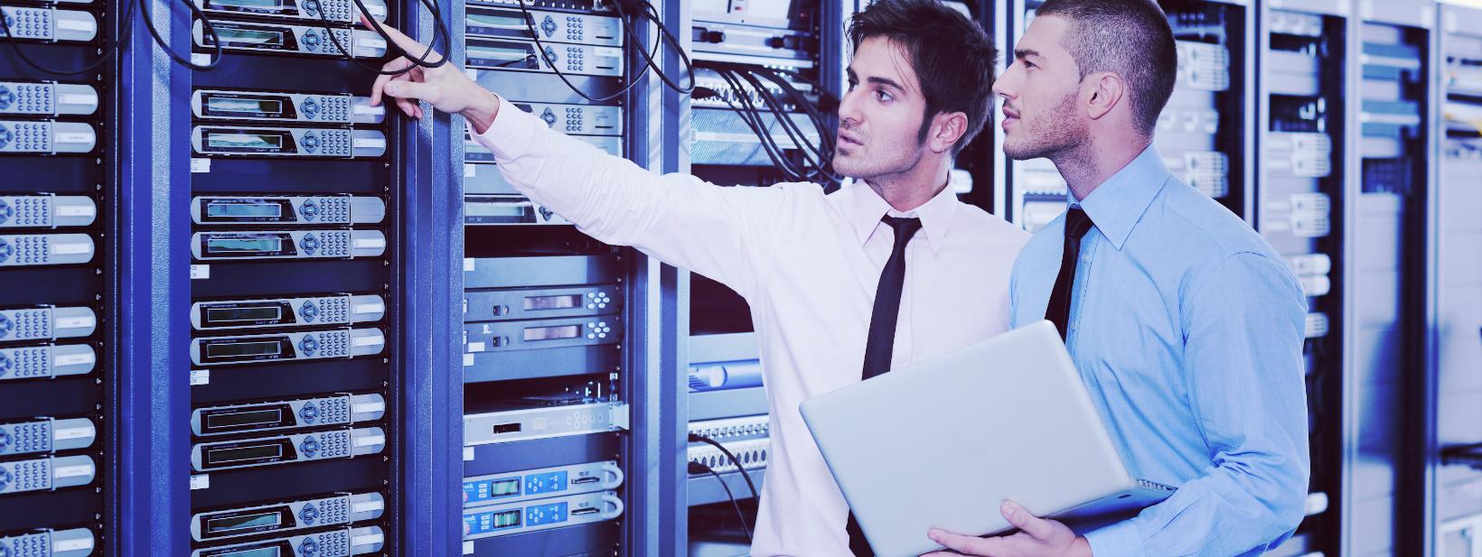 it-enineers-in-network-server-room-2021-04-02-19-39-08-utc.png