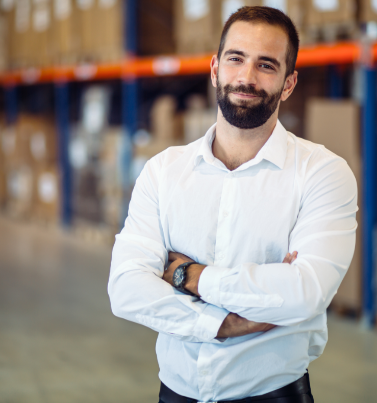 logistics-manager-posing-in-warehouse-ZHLRUEB.png