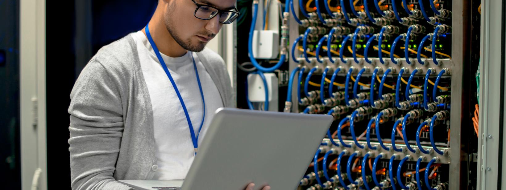 young-engineer-managing-supercomputer-servers-2021-04-02-23-20-34-utc.png